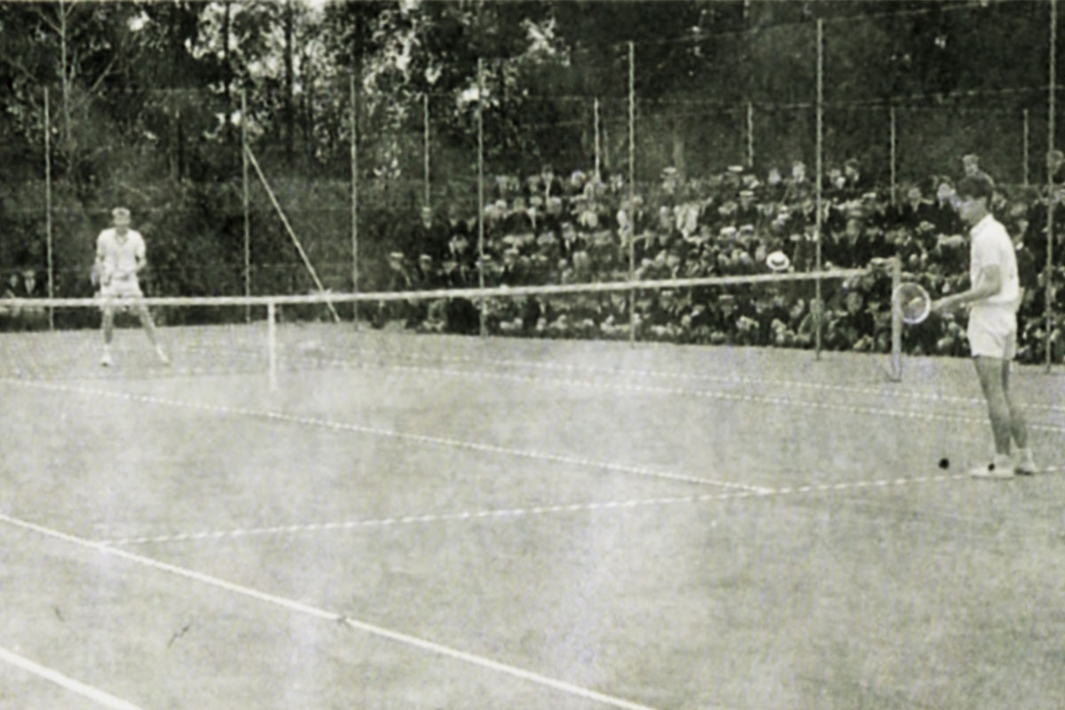 A game of tennis with the school looking on